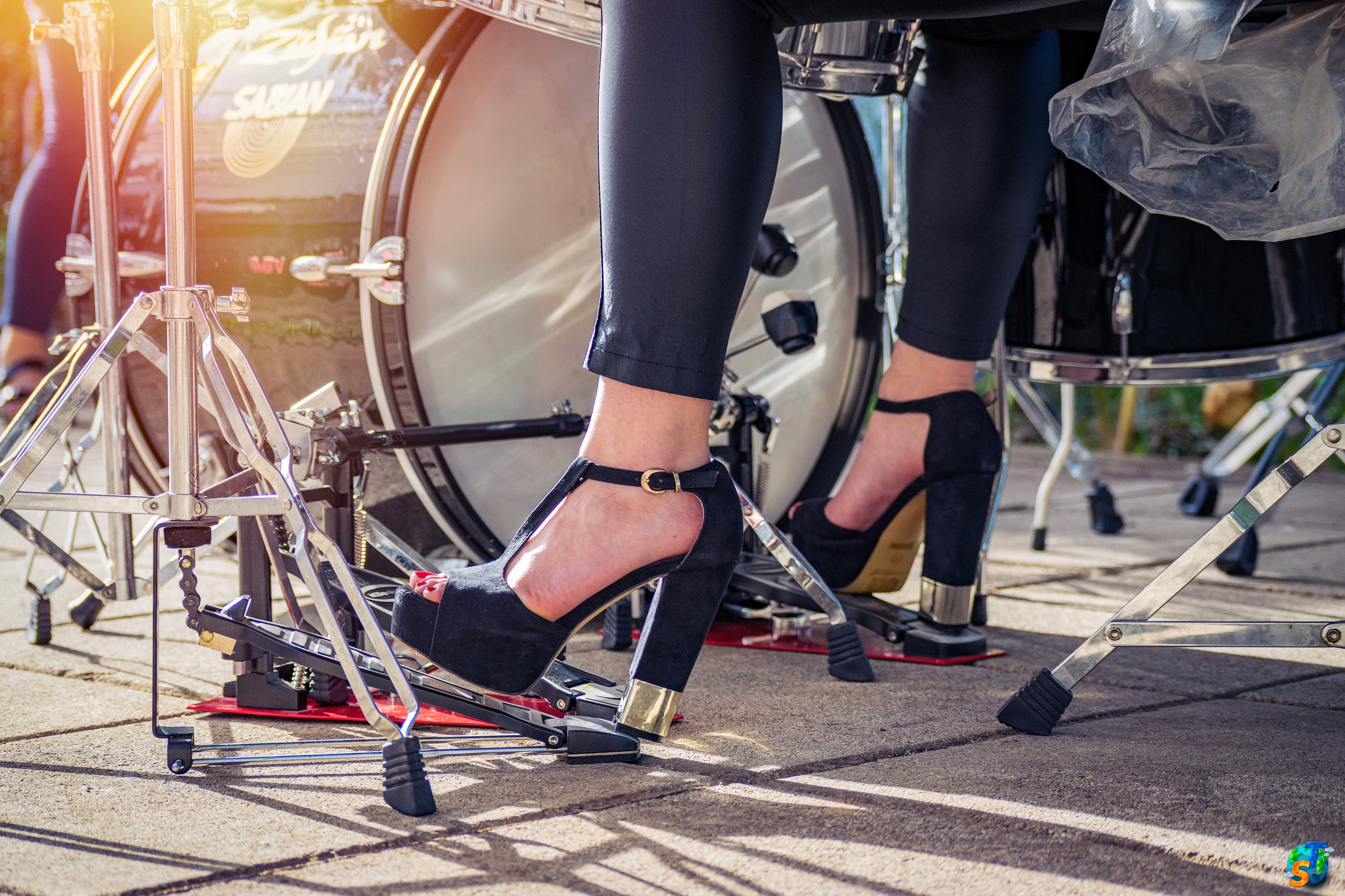 playing drums in high heels outdoors